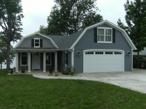 After: Gravel Lake home, from the street